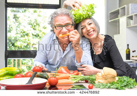 stock-photo-senior-couple-having-fun-in-kitchen-with-healthy-food-retired-people-cooking-meal-at-home-with-424476892